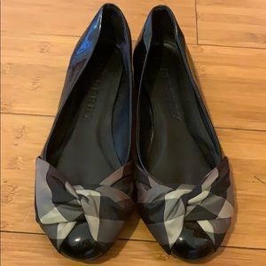 Burberry patent flats with plaid bow front.